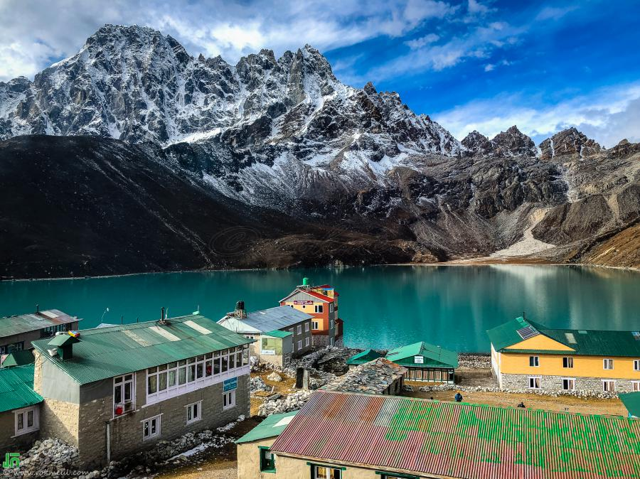 Gokyo Village and Gokyo Lake, view from Namaste Lodge. Behind the lake is the Phari Lapcha Peak with the elevation of 6017m.